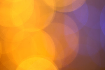 Golden glitter christmas abstract bokeh background. Blurred lights backdrop