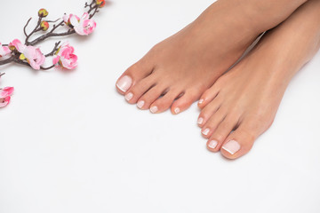 Wall Murals Pedicure Female feet with nice pedicure isolated on white background.