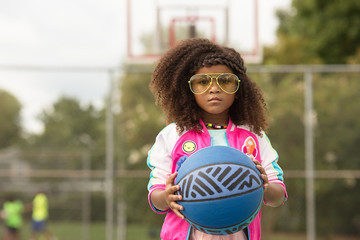 Close up of young girl holding basketball