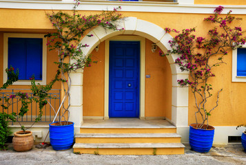 traditional greek front door and flowers