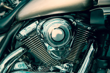 The motor is a modern and powerful motorcycle. Cylinder block close-up. Chrome parts road motorcycle.