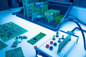 Electrical engineering.Workplace electronic engineer.Electronics manufacturing.Testing of electronic devices.Vertical storage of printed circuit boards.omponents for electronic devices.Chips