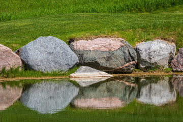 large rocks reflecting in water