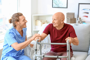 Elderly man with caregiver in nursing home