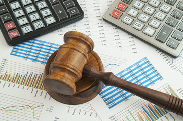 Arbitration concept, judge gavel and calculators on financial documents