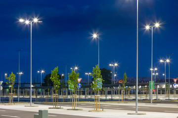 big modern empty parking area with LED street lights at evening Fototapete