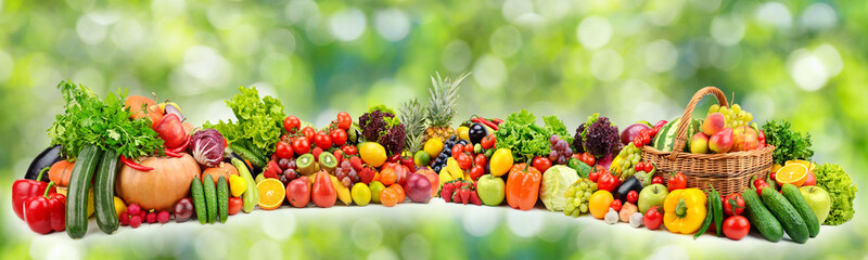 Ripe vegetables and fruits on natural green background Wall mural