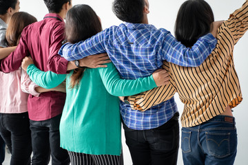 back view of friend holding hands and hug each other over white background