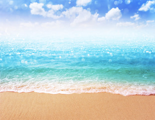 Fototapete - pink flamingo on beautiful sandy beach and soft blue ocean wave summer concept background