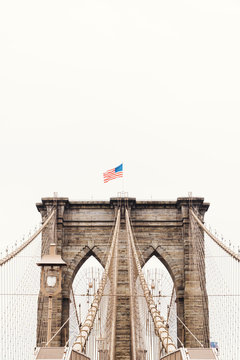 Brooklyn Bridge with US flag