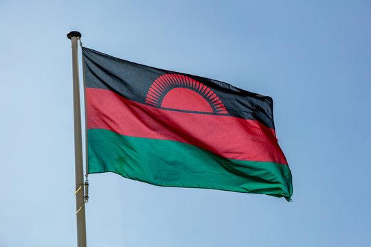 Malawi flag waving against clear blue sky