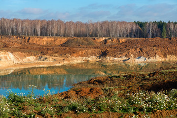 Top view of the place of extraction of sand in a sand pit in the autumn afternoon