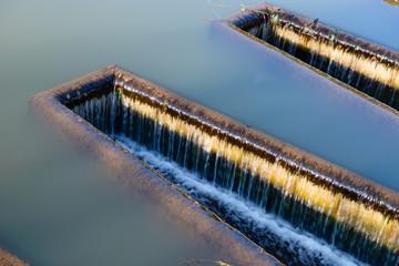 Spillway on a river dam on an autumn day