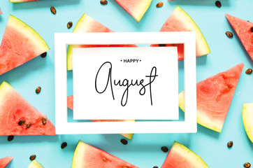 Inscription Happy August. Fresh red watermelon slice Isolated light blue background. Top view, Flat lay. - Image