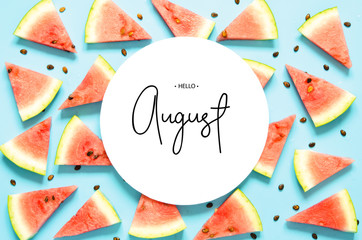 Inscription Hello August. Fresh red watermelon slice Isolated light blue background. Top view, Flat lay. - Image