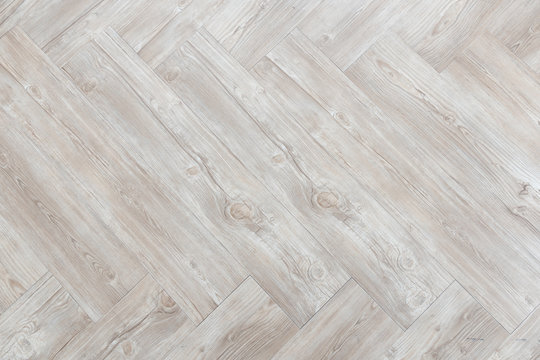 top view of brown wooden herringbone floor background texture.