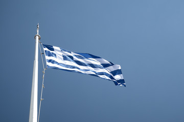 Greek flag from ferry against clear blue sky