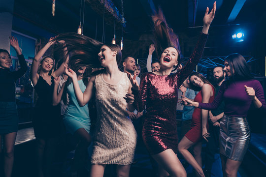 Nice cool gorgeous lovely attractive glamorous cheerful glad positive stylish girls and guys having fun weekend occasion festal celebratory feast in fashionable luxury place night-club indoors