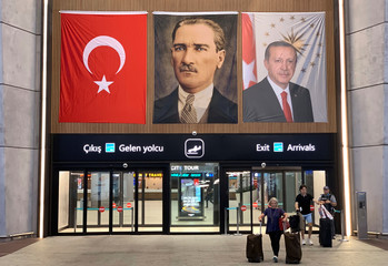 People exit from the international arrivals terminal at the new Istanbul Airport in Istanbul