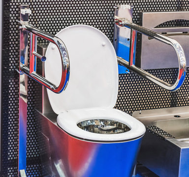 Toilet for disabled people with metal handrails for installation in vehicles, trains, buses and other.
