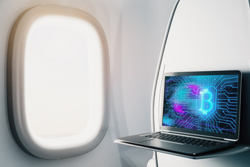 Laptop closeup inside airplane with bitcoin theme pic on screen. Blockchain concept. 3d rendering.