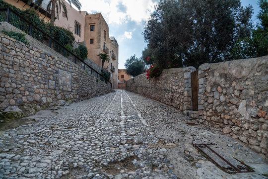 Typical street in historic center, Dalt Vila of Ibiza, Eivissa, Balearic Islands. Spain.