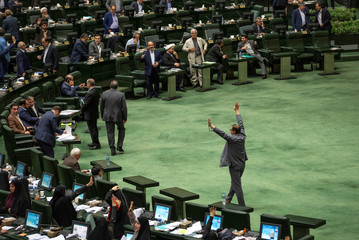 Iranian lawmakers attend a session of parliament in Tehran
