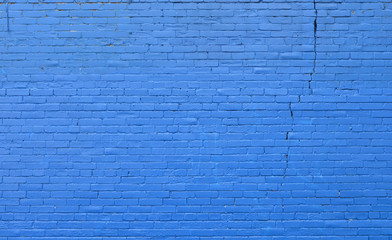 Brick wall painted with dark blue paint.