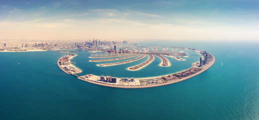 Aerial view on Palm Jumeirah island in Dubai, UAE, on a summer day.