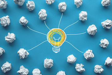 Creativity inspiration,ideas concepts with power of lightbulb and paper crumpled ball on color background