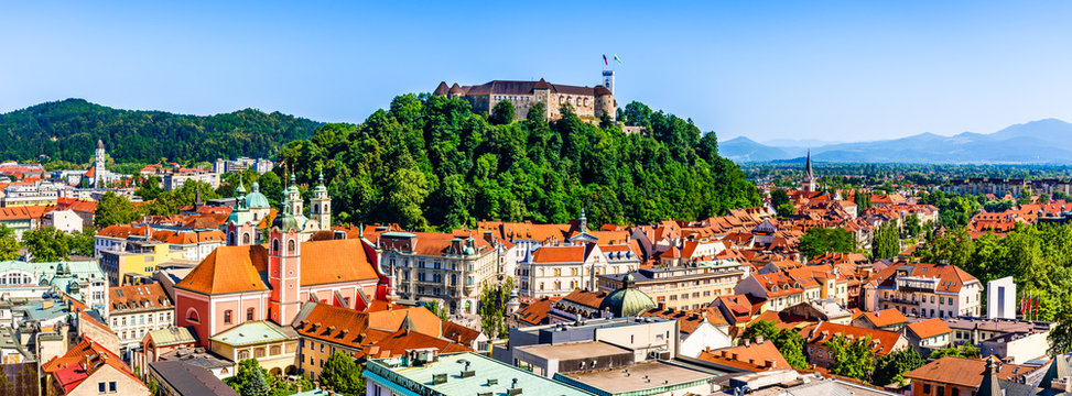 Old town and the medieval Ljubljana castle on top of a forest hill in Ljubljana, Slovenia