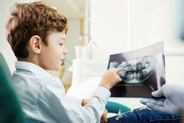 Children's dentistry. A child in the dental office