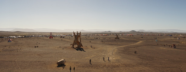 Burning Man wooden structures at the AfrikaBurn Festival in the Karoo Desert in Tankwa Karoo National Park near Cape Town, South Africa.