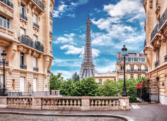 Garden Poster Eiffel Tower Small Paris street with view on the famous Eiffel Tower in Paris, France.