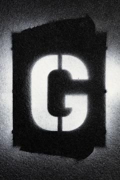 Letter G grunge spray paninted stencil font