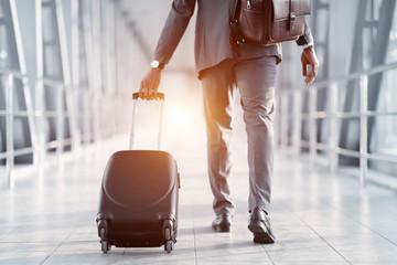 Fototapeta Businessman Hurrying on Plane, Walking Through Passenger Bridge obraz