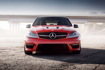 Saratov, Russia - August 24, 2014: Red Car Mercedes-Benz C63 AMG Edition 507 is parked on asphalt road at sunset