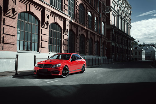 Moscow, Russia - July 10, 2016: Red car Mercedes-Benz C63 AMG Edition 507 is parked on asphalt road in the city Moscow at daytime