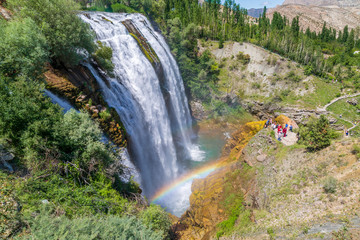 Tortum (Uzundere) waterfall from top during summer season with rainbow in Erzurum, Turkey