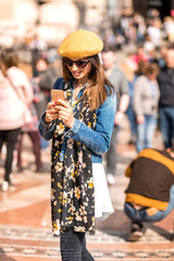 A woman using her smartphone in the pedestrian zone