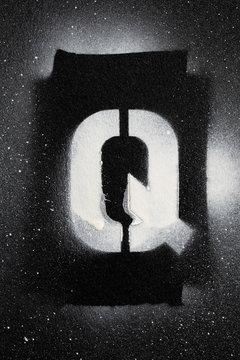 Letter Q grunge spray paninted stencil font