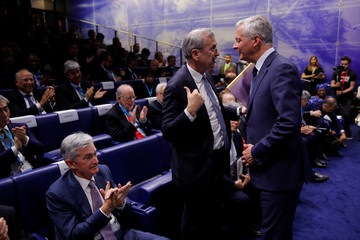 """French Finance Minister Le Maire talks with Governor of the Bank of France Villeroy de Galhau after his speech during a conference entitled """"Bretton Woods: 75 years later"""" in Paris"""