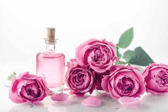 Roses, perfume essence.