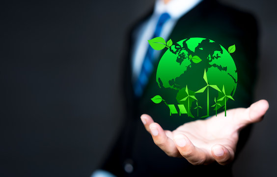 Green world in the hands of businessman, eco-friendly business. Business and Environmental concepts with copy space
