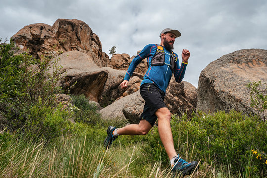 Male runner running on a mountain trail