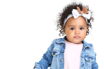 Beautiful baby girl in fashion clothing on white background