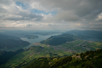 view from the Stanserhorn down on Lake Lucerne with clouds in the sky