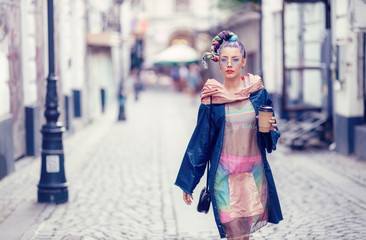 Single young teenage female with extravagant look on streets. Crazy appearance on boulevard. Avant-garde fashion concept