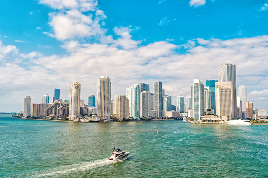 Business district Miami. Richness concept. Architecturally impressive high rise towers. Skyscrapers and harbor. Must see attractions. Miami waterfront lined with marinas. Downtown Miami city center