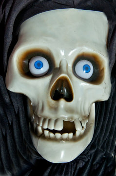 Halloween costume Skull with blue eyes and missing teeth